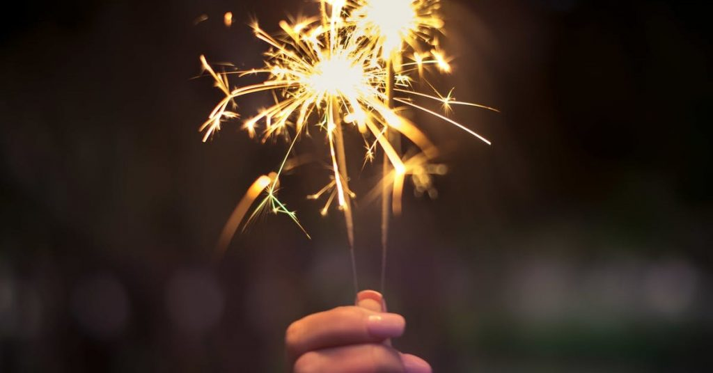 Sparkler held in person's hand.