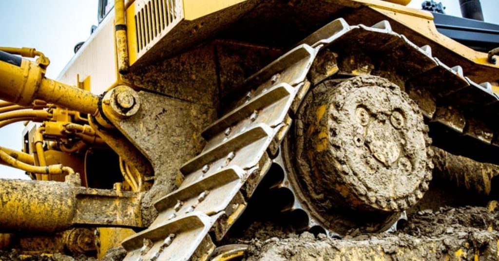 close up view of construction machinery from the ground