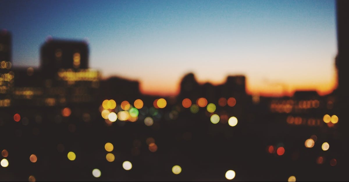 Blurred lights of a city skyline, construction at night