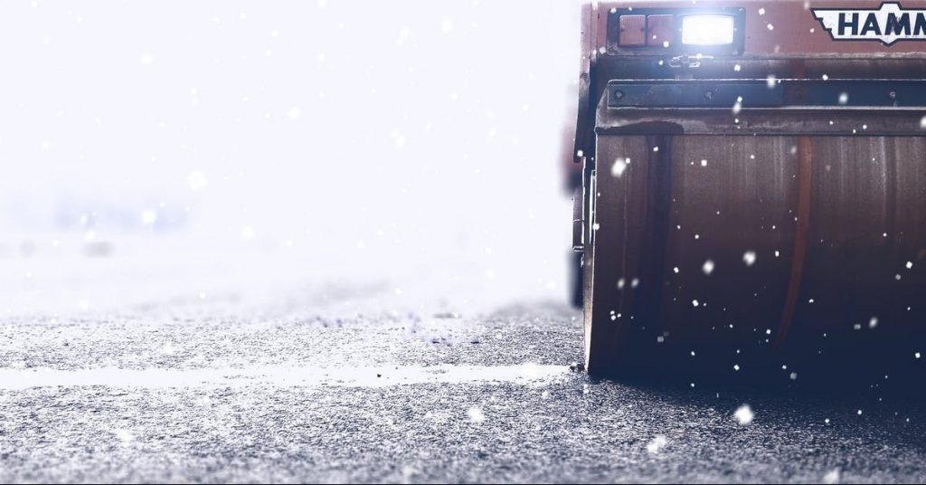 working vehicle in snowstorm